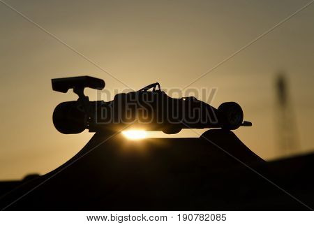 Outline of beautiful single-seater with sunset in background