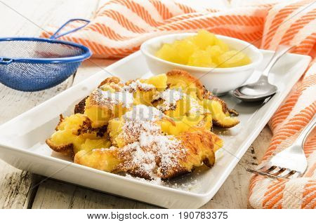 warm kaiserschmarrn served with homemade apple compote and powdered sugar