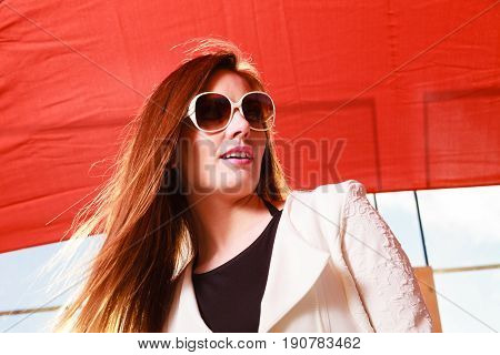 Fashion and posing during sunny day concept. Beautiful girl in summer. Young pretty woman spending spare time.