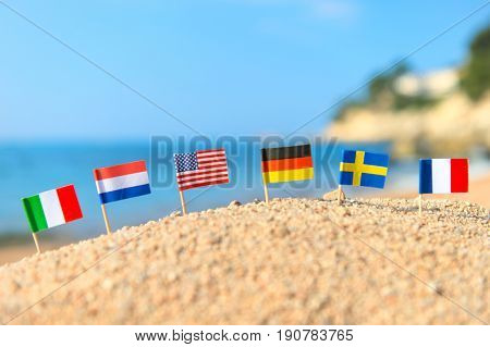 European beach with row little flags