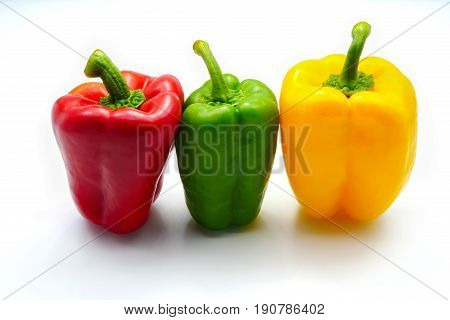 Sweet red green yellow color bell pepper isolated on white background