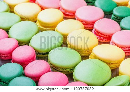 Colorful tasty macaroons a french sweet delicacy macaroon texture close up