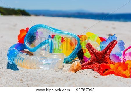 Diving mask and star fish on the beach in summer