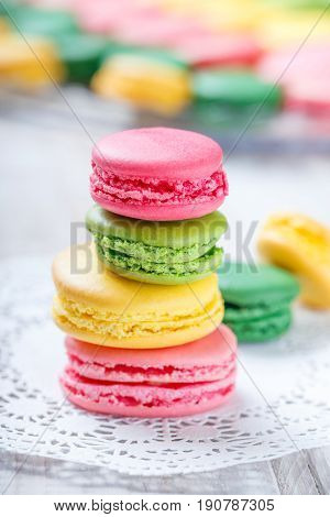 Colorful tasty macaroons on napkin natural light selective focus. Sweet and colorful dessert close up