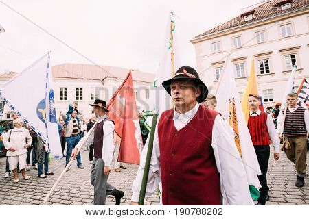Vilnius, Lithuania - July 6,2016: People dressed in traditional costumes take part in ceremonial procession with flags on Statehood Day. Holiday in commemorate coronation in 1253 of Mindaugas King.