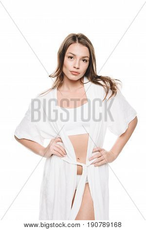 Portrait Of Sexy Woman In White Robe Standing Akimbo Isolated On White
