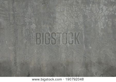 Background cement texture cracks dark gray color tone full frame.