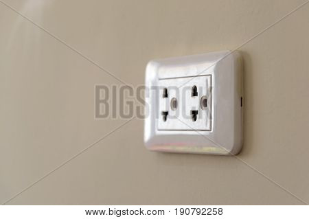 Closeup the electrical plug socket on the wall.