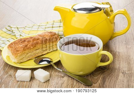 Flaky Cookies, Teapot, Cup Of Tea, Spoon And Lumpy Sugar
