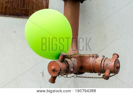 Hydrant with water hoses and fire extinguish equipment with Green balloons