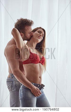 Man Unbuttoning Woman's Jeans