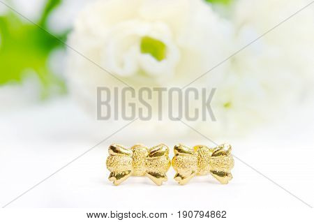 Gold Pendant Cameo Earring Jewelry In Bow Shape With Flowers Isolated On White