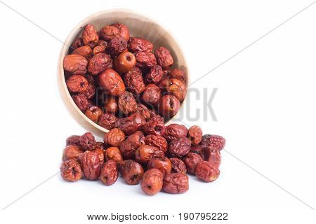 dried jujube fruits chinese herbal medicine in bowl isolated on white background