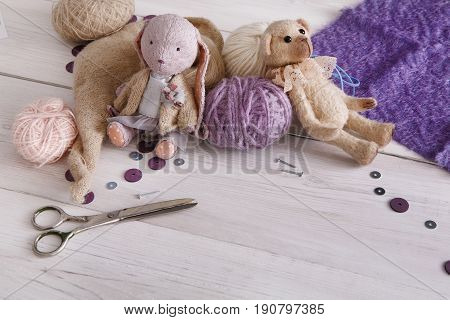 Handmade toy making, artisan workplace background. Bear and materials for creating vintage plaything, home workshop, copy space for text