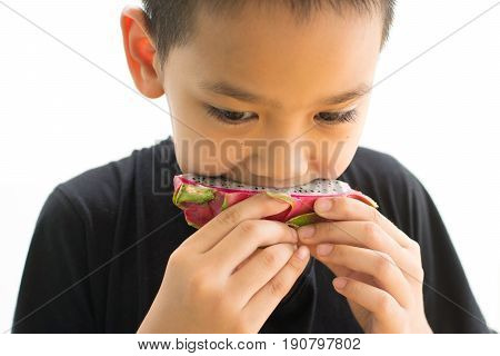 Asian eating the dragon fruit isolated on white background
