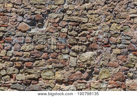 Stone wall made of old stone structure.