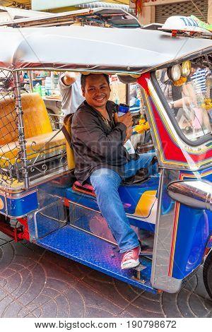 BANGKOK THAILAND - APRIL 24: Tuk tuk driver wait for client on the street of Bangkok Chinatown on April 24 2016 in Bangkok Thailand.