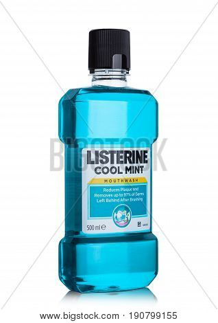 London, Uk - June 9, 2017: Listerine Mouthwash Container On White. Listerine Is A Brand Of Antisepti