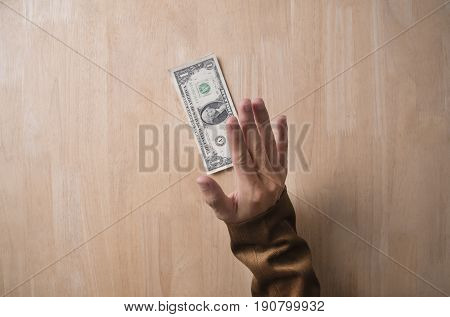 businessman refusing money from a bribe on wooden table in office. concept offer money finance.