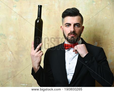 Bearded White Collar Worker Holds Bottle Of Alcoholic Drink