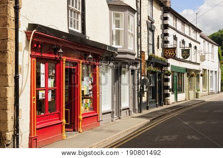 Llangollen Wales UK - June 9 2017: Bridge street in Llangollen with it's quaint terraced cottages and shops a popular destination for visitors and tourists the town also hosts the annual International musical Eisteddfod
