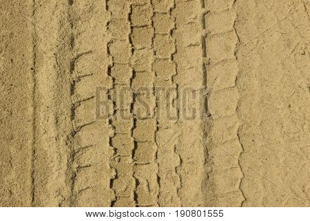 Trace Of Tire On A Sand . Sand Texture