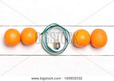Orange Fruit Line And Cyan Measuring Tape With Light Bulb