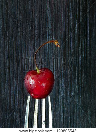 Close-up of a cherry on a fork