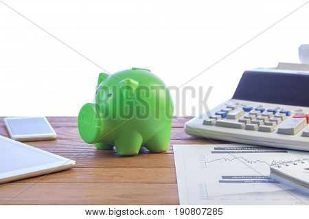 Business Man Putting Money Coin Into Green Piggy Bank, Finance And Investment Concept