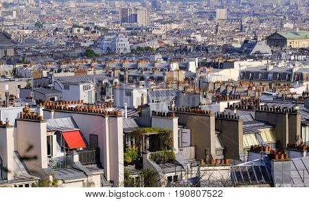 a view of the rooftops of paris and the city beyond