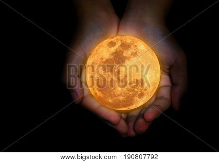 Female Hand Hold Yellow Full Moon.