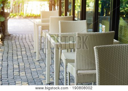White Rattan Chair And Table Decoration In Restaurant , Process In Sun Light Filter Effect