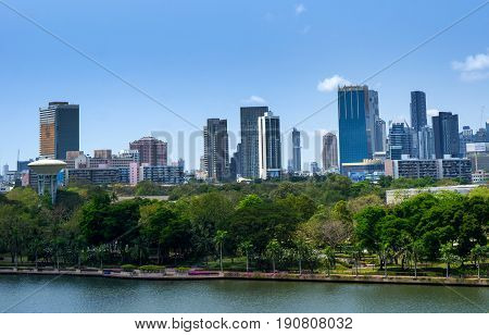 Bangkok City And Modern Office Buildings And Garden In Aerial View