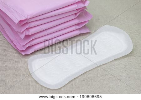 Medical concept photo. Menstrual woman pads for blood period. Menstruation sanitary soft pads hygiene protection. Woman critical days gynecological menstruation cycle