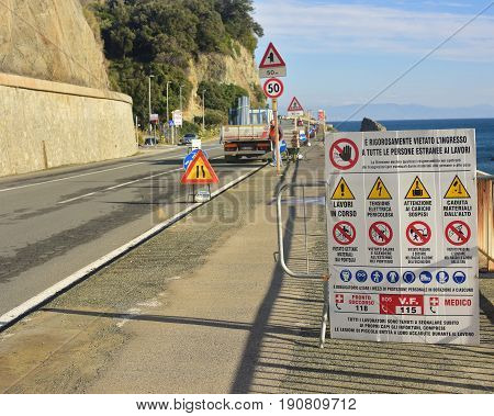 Road signs to warn motorists and pedestrians to pay attention to road works