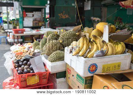 KOWLOON HONG KONG - APRIL 21 2017: Durian Bananas and Mangosteen Fruits at Street Market in Kowloon Hong Kong.