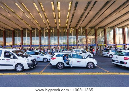 Rome Italy - September 12 2016: Taxi cars are near the taxi stop and queue from people at entrance of Termini Train Station in Rome