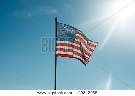 View of Flag of the United States of America with sunflare