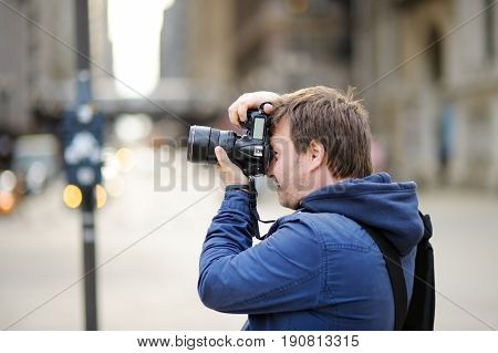 Photographer Taking Photo With Professional Digital Camera
