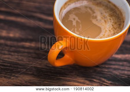 Orange Coffee Cup On Old Wooden Table