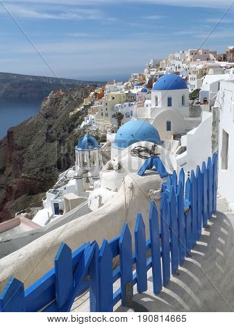 White and blue Greek Islands traditional churches architecture at Oia village, Santorini island, Greece