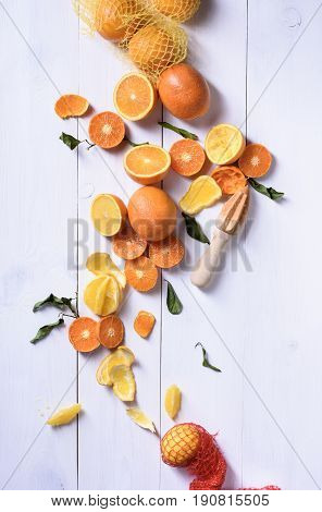 Fresh Oranges, Slices Of Orange Fruits For Making Juice. Ripe Citrus Fruits With Juice Squeezer.