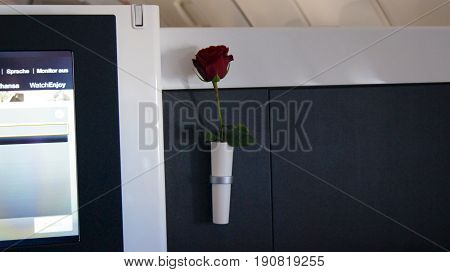 FRANKFURT, GERMANY - SEPTEMBER 2014: Traveling Lufthansa First Class in a Boeing 747-400 Upper Deck - inflight entertainment and the famous red rose.