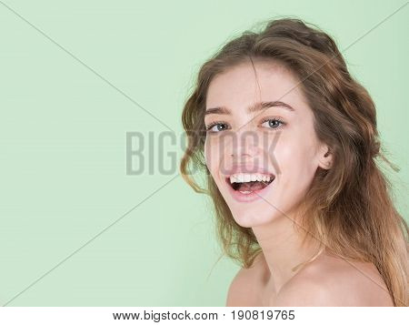 Happy, Pretty Woman Smiling With Healthy Teeth
