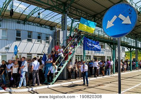 Uzhgorod Ukraine - June 11 2017: Local residents are waiting for the start of a symbolic ceremony on the Slovak-Ukrainian border on the occasion of the introduction of a visa-free regime between Ukraine and the Schengen countries.