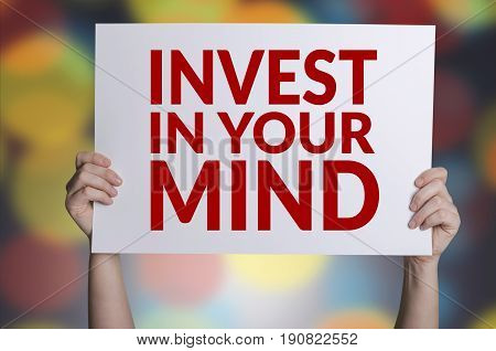 Invest in your mind card in hand with bokeh background