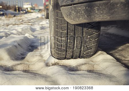 Winter tyres of a cars on a snowy road