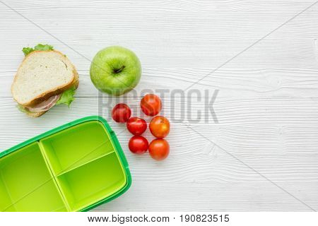 Homemade Lunch With Apple, Tomato And Sandwich In Green Lunchbox Top View Mockup