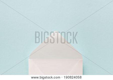 White envelope on a blue background. mock up