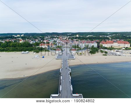 Sopot, Poland - June 10 2017: Aerial view of the wooden pier against the Sheraton hotel in the background in morning time